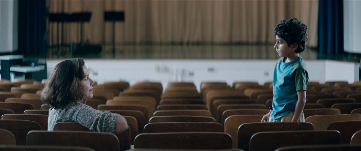 Maggie Gyllenhaal opposite a young boy in an auditorium in The Kindergarten Teacher