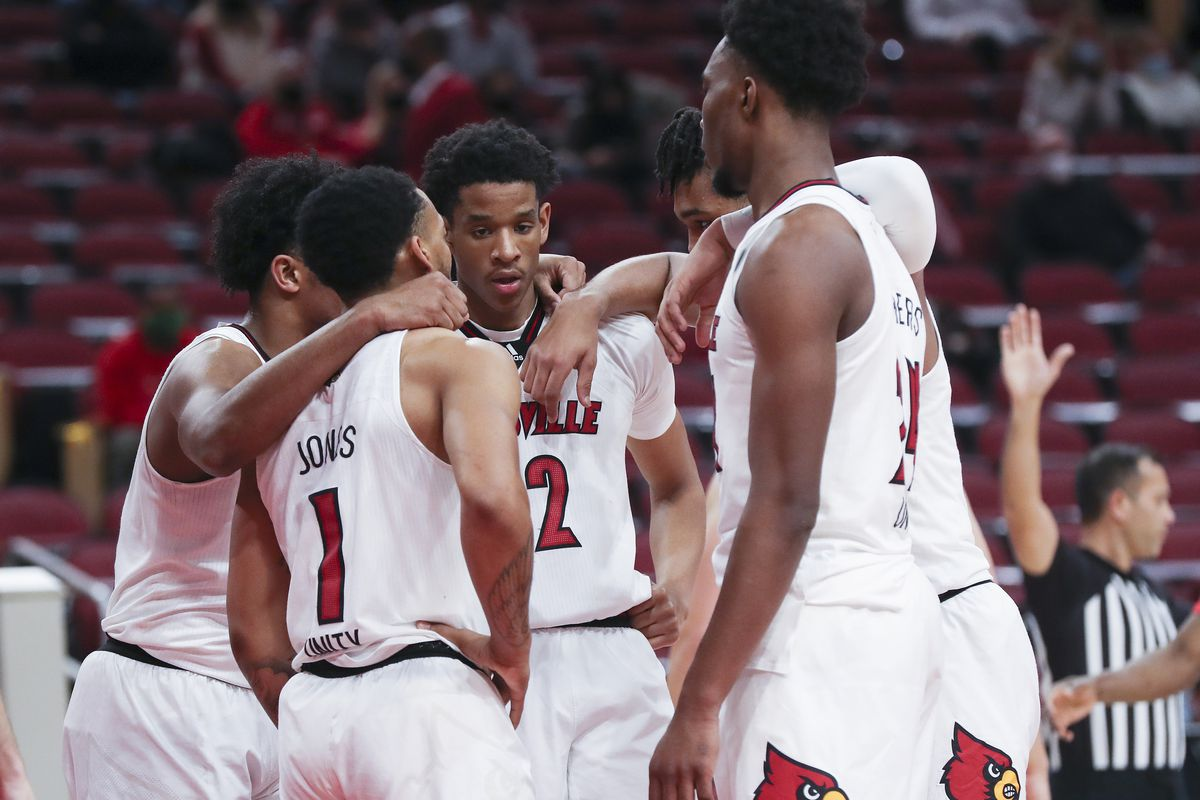 Louisville Cardinals players huddle during a game against Western Kentucky at the KFC Yum! Center.