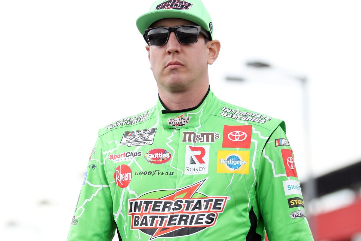 Kyle Busch, driver of the Interstate Batteries Toyota, walks on the grid before qualifying for the NASCAR Cup Series Auto Club 400 at Auto Club Speedway on February 29, 2020 in Fontana, California.
