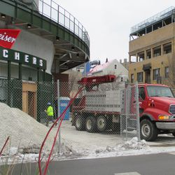 Mon 1/4: cinderblock delivered to the bleacher gate -