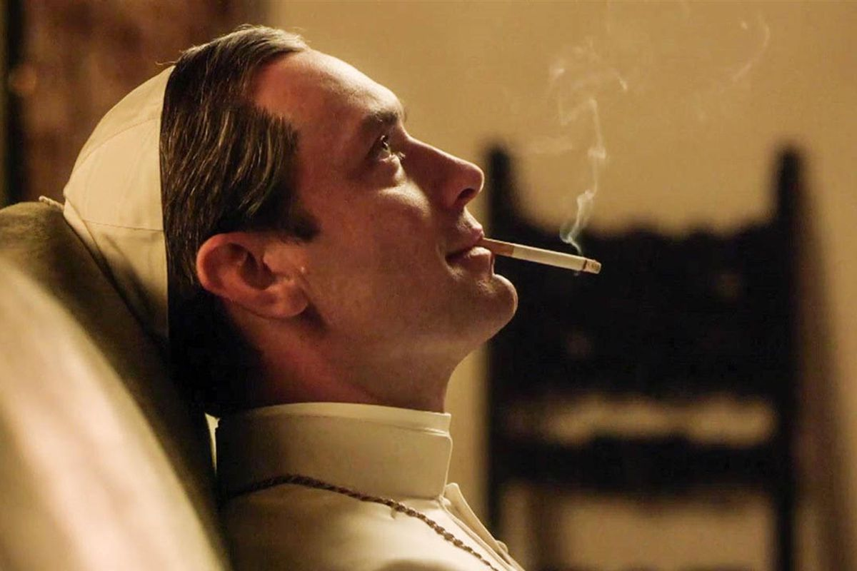Playing the title character in HBO's The Young Pope, Jude Law smokes a cigarette.