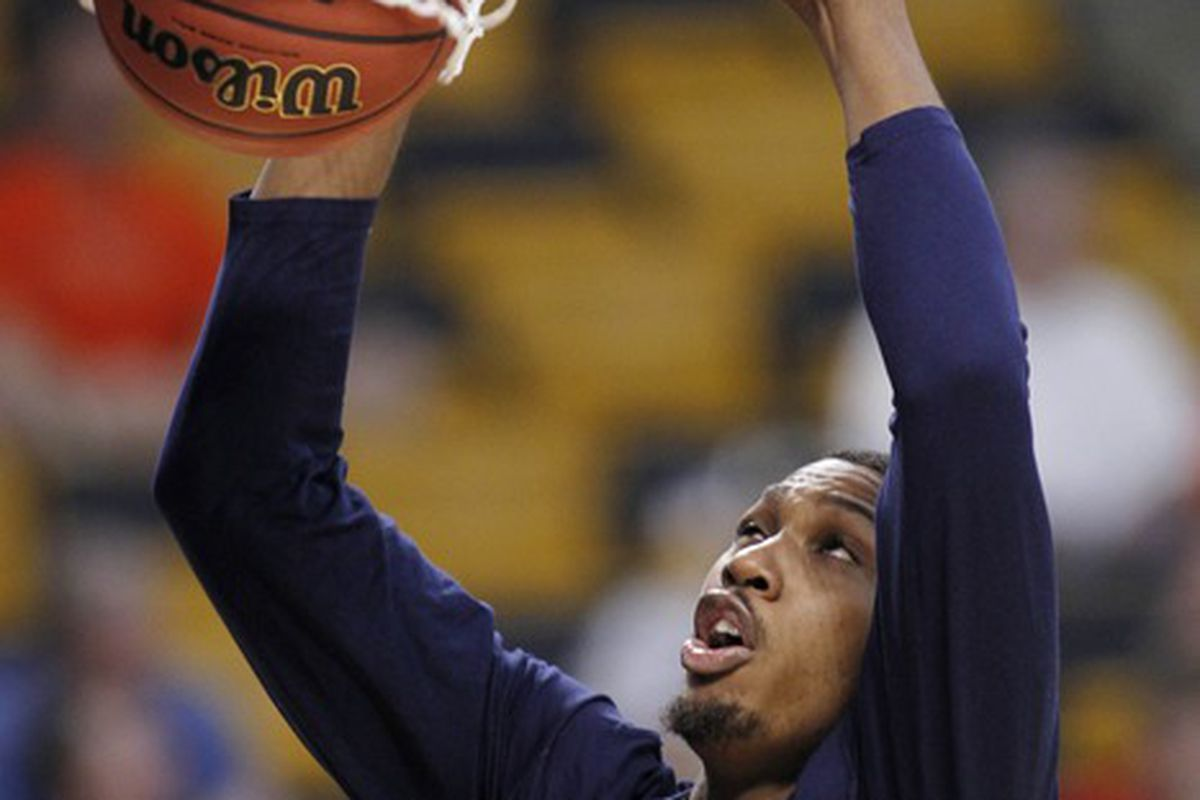 Mar 21, 2012; Boston, MA, USA; Syracuse Orange forward Kris Joseph dunks during practice the day before the semifinals of the east region of the 2012 NCAA men's basketball tournament at TD Garden.  Mandatory Credit: Greg M. Cooper-US PRESSWIRE