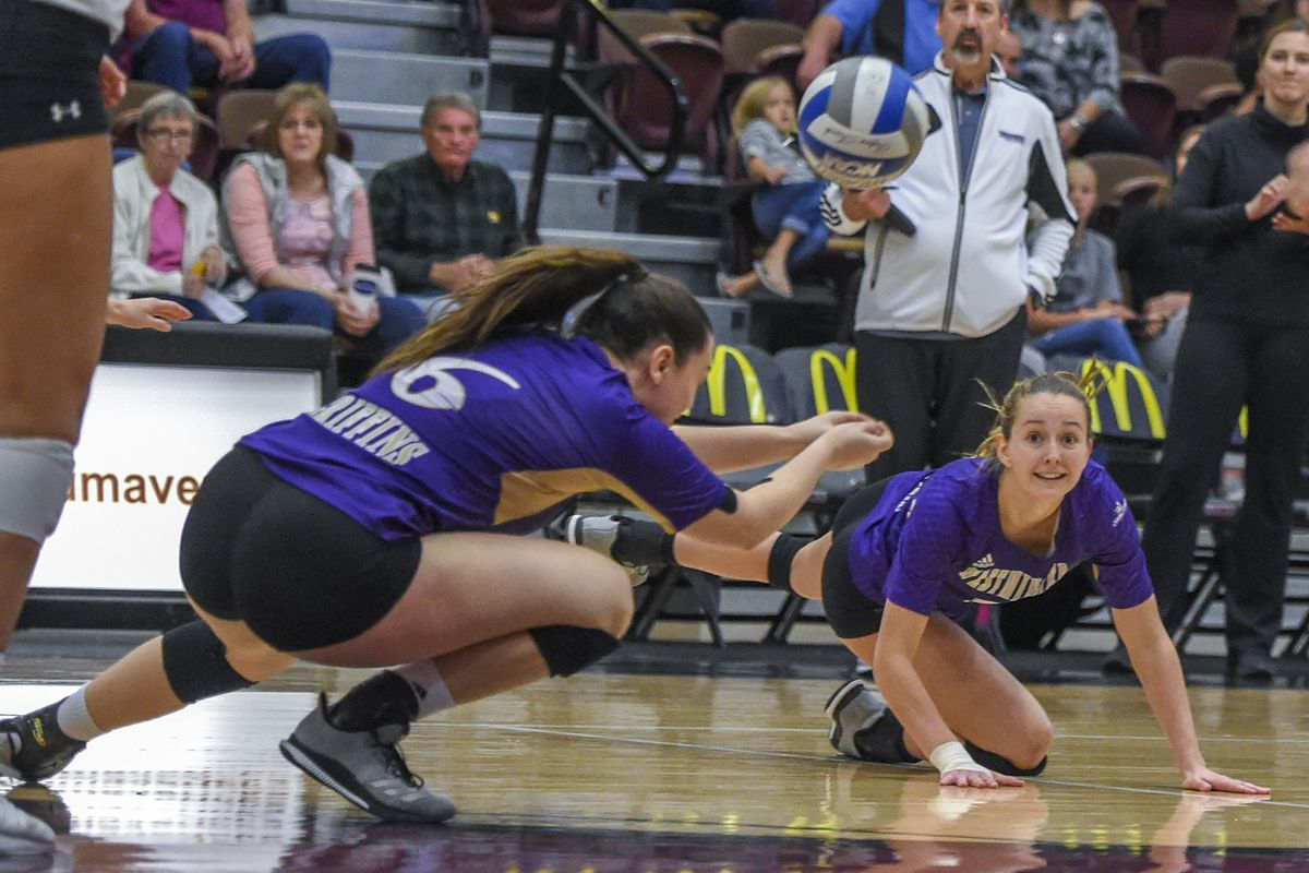 Taylor Harvey (left) and Katie Jacox (right) work to dig a ball.