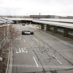 Airport police patrol the drop-off area outside of the Salt Lake City International Airport after a 5.7 magnitude earthquake centered in Magna caused the airport to be evacuated and closed on Wednesday, March 18, 2020.