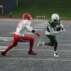 Antoine Porter eluding a Ball State defender on route to Eastern Michigan's first touchdown.
