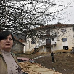 """Time Osmankaj, a relative of Sami Osmankac, stands in front of the house where naturalized American citizen Sami Osmakac, 25, was born, in the Osmankaj family compound in the village of Lubizde, Kosovo Tuesday, Jan 10, 2012. Kosovo-born man Sami Osmakac was charged with plotting to attack Tampa-area nightclubs and a sheriff's office with bombs and an assault rifle to avenge wrongs done to Muslims, according to federal authorities. According to a federal complaint, Osmakac recorded an eight-minute video shortly before his arrest explaining why he wanted to bring terror to his """"victims' hearts"""" in the Tampa Bay area. (AP Photo/Visar Kryeziu)"""