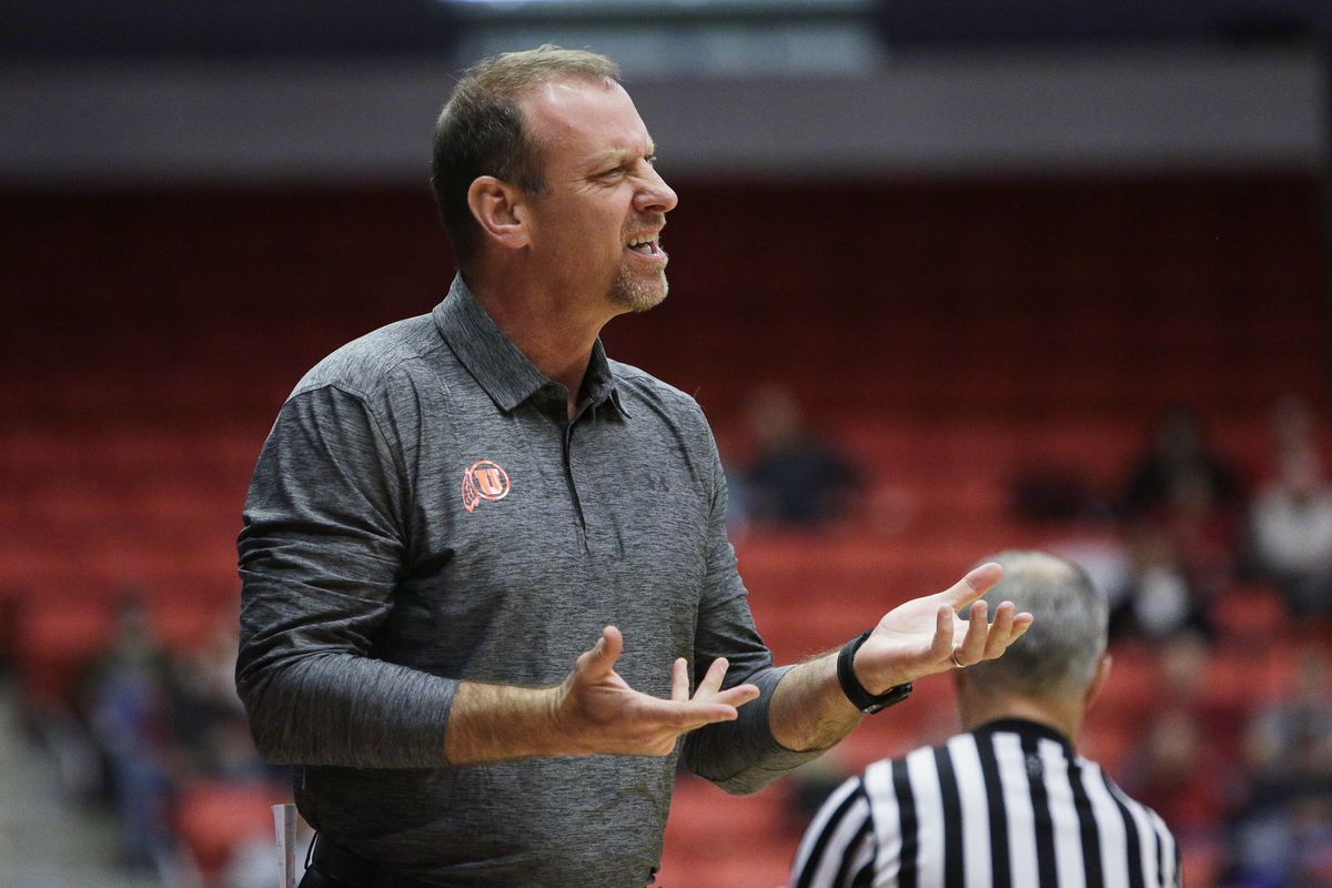 CORRECTS TO FIRST HALF INSTEAD OF SECOND - Utah head coach Larry Krystkowiak directs his team during the first half of an NCAA college basketball game against Washington State in Pullman, Wash., Wednesday, Jan. 18, 2017. (AP Photo/Young Kwak)