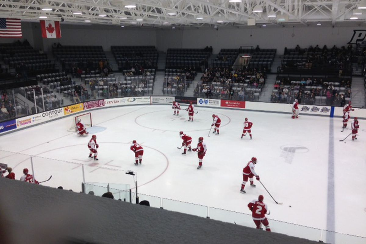 Miami players warm up prior to a game against Providence College on October 26, 2013.