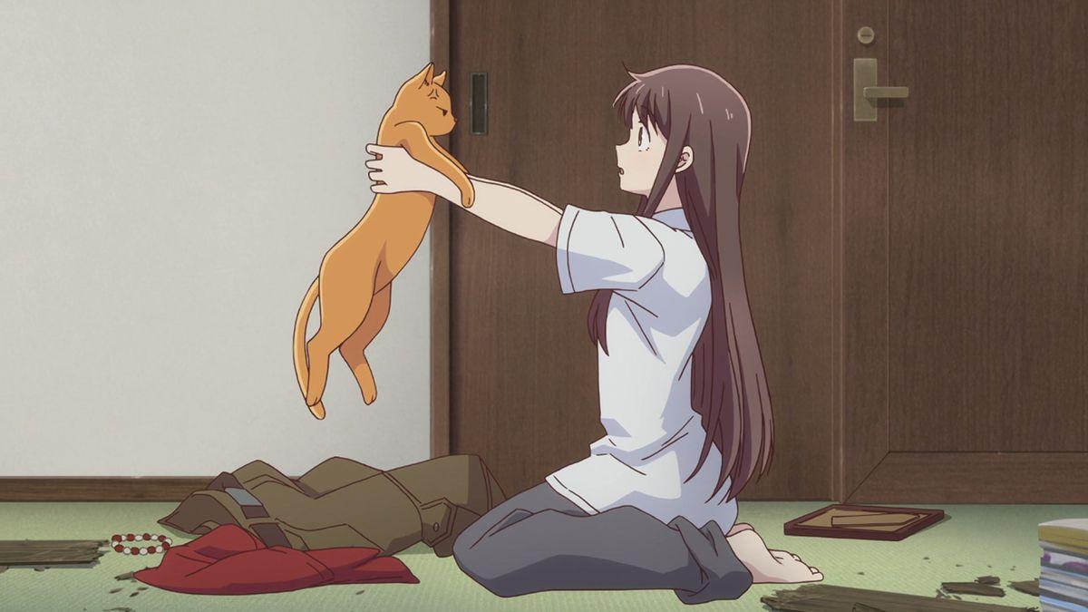 Tohru Honda holds up an orange cat, in shock