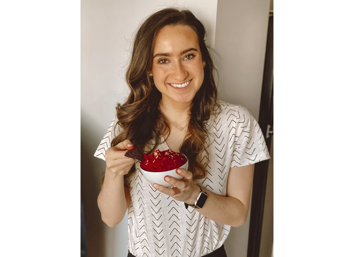 Caroline Hoffman, 25, holding her homemade beet hummus in Chicago on Jan. 23, 2021. Beets never got a chance from Hoffman, until the pandemic arrived and she forgot to buy tomatoes for pizza sauce one day and blended up some beets instead. She has made beet hummus, beet pasta and beet salads since then