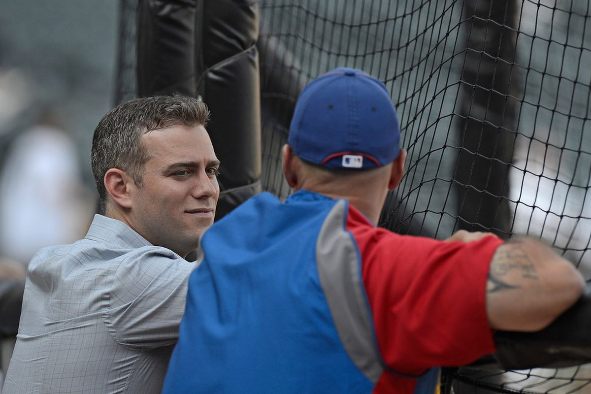 CHICAGO, IL - JUNE 18: Theo Epstein, President of Baseball Operations for the Chicago Cubs (L), acts as if he's listening to Dale Sveum, the Cubs manager, while actually staring at a girl.