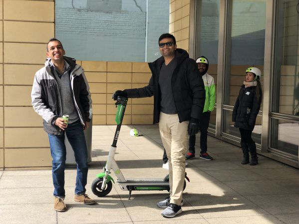 Kush Patel (left) and Archit Joshipura (right) called electric scooters a 'game changer' after testing them out at Lime's downtown event Saturday. | Savannah Eadens/Sun-Times