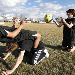 Taylor Booth practices soccer in Layton Thursday, March 12, 2015.