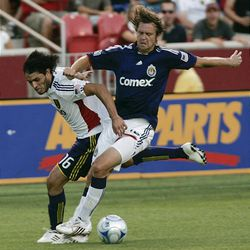 RSL's Fabian Espindola, left, defends Carey Talley of Chivas USA Wednesday at Rio Tinto Stadium.