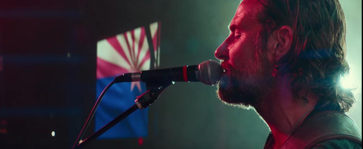 Bradley Cooper singing onstage