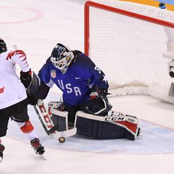 Madeline Rooney #35 of the United States makes a save against Meghan Agosta #2 of Canada in a shootout.
