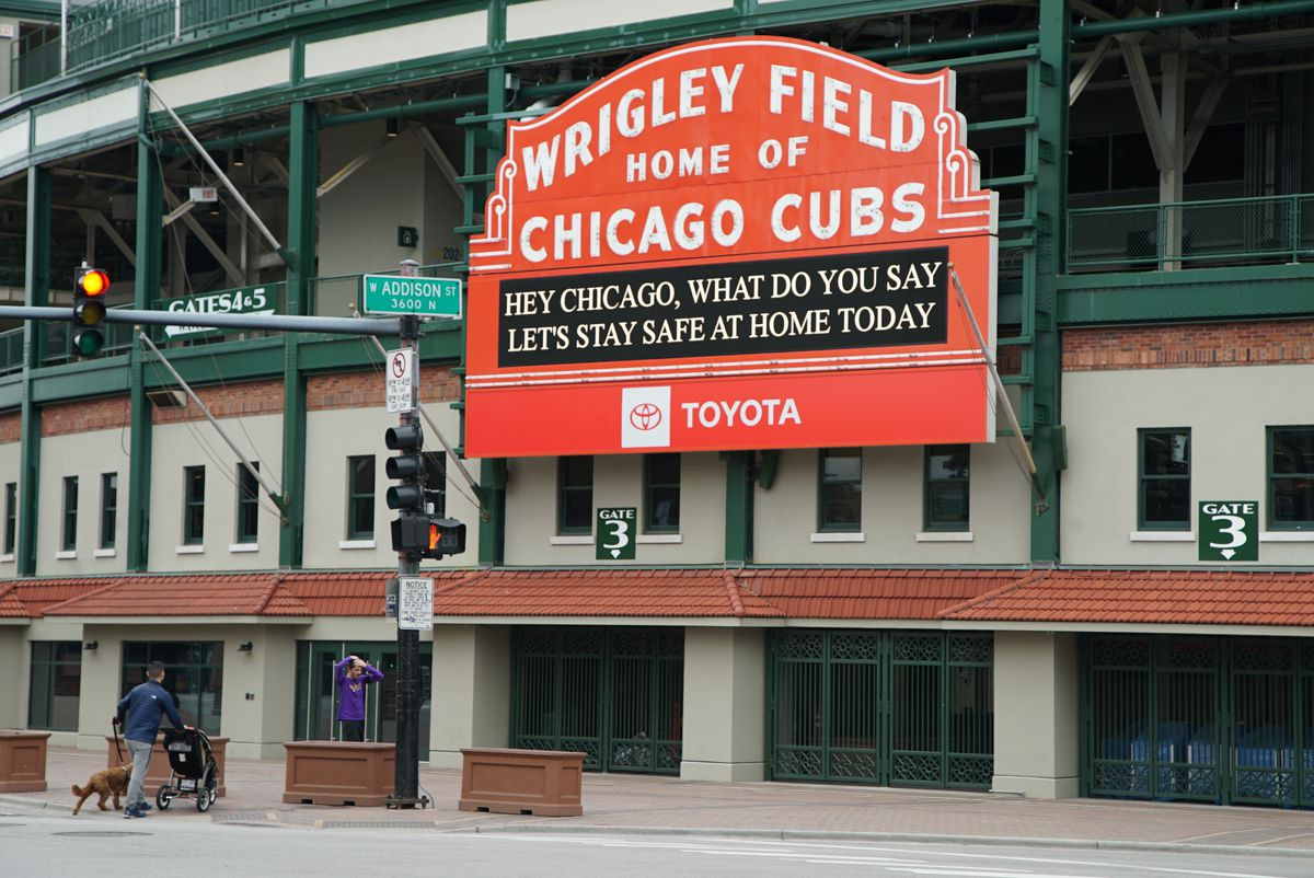 The marquee at Wrigley Field encourages Chicagoans to stay home during the coronavirus pandemic, Monday afternoon, April 6, 2020.