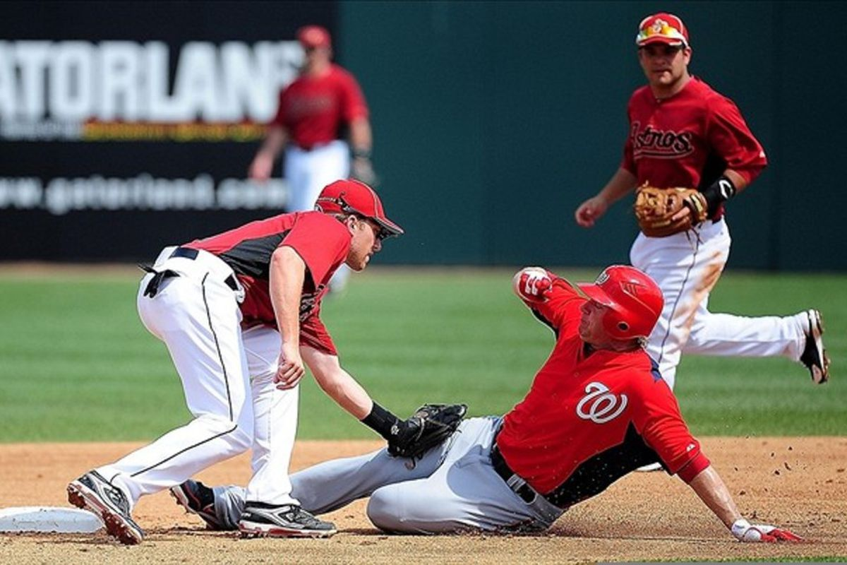 Mar. 3, 2012; Kissimmee, FL, USA; Washington Nationals outfielder Jason Michael (12) gets tagged out by Houston Astros shortstop Jed Lowrie (4) at Osceola County Stadium. Mandatory Credit: Andrew Weber-US PRESSWIRE