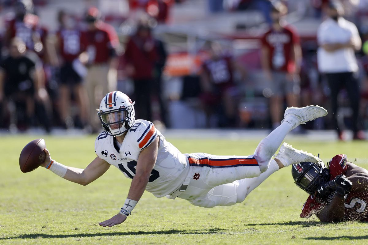Bo Nix of the Auburn Tigers tries to pass the ball as he is upended by Keir Thomas of the South Carolina Gamecocks in the fourth quarter of the game at Williams-Brice Stadium on October 17, 2020 in Columbia, South Carolina.