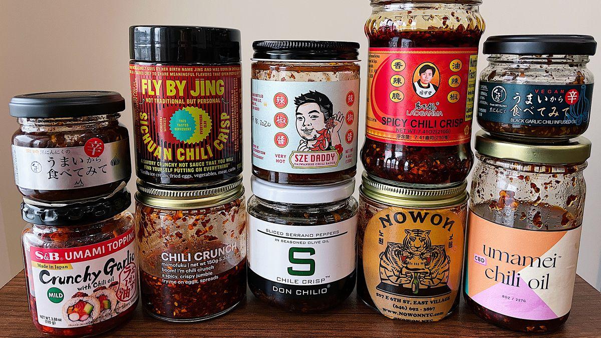 Ten assorted jars of various different chile crisp brands.