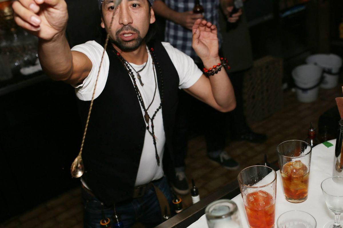 Bartender Jean Vasquez plays to the crowd at Drunken Masters