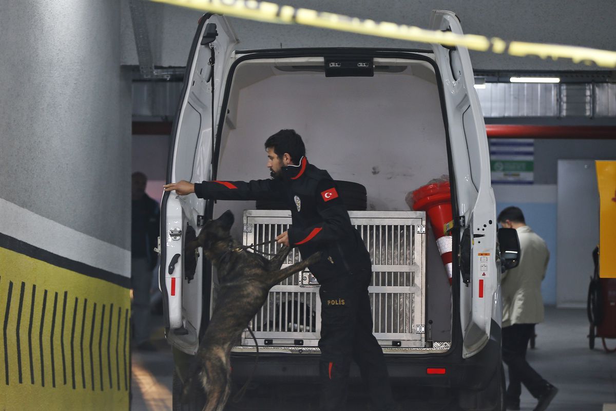 Turkish police crime scene investigators, looking for possible clues into the killing of Saudi journalist Jamal Khashoggi, work in an underground car park, where authorities Monday found a vehicle belonging to the Saudi consulate, in Istanbul, Tuesday, Oc