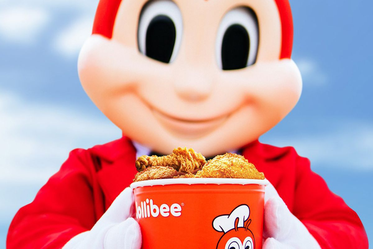 """A bucket of fried """"chickenjoy"""" held by its bee mascot, now available at Jollibee in Henderson."""