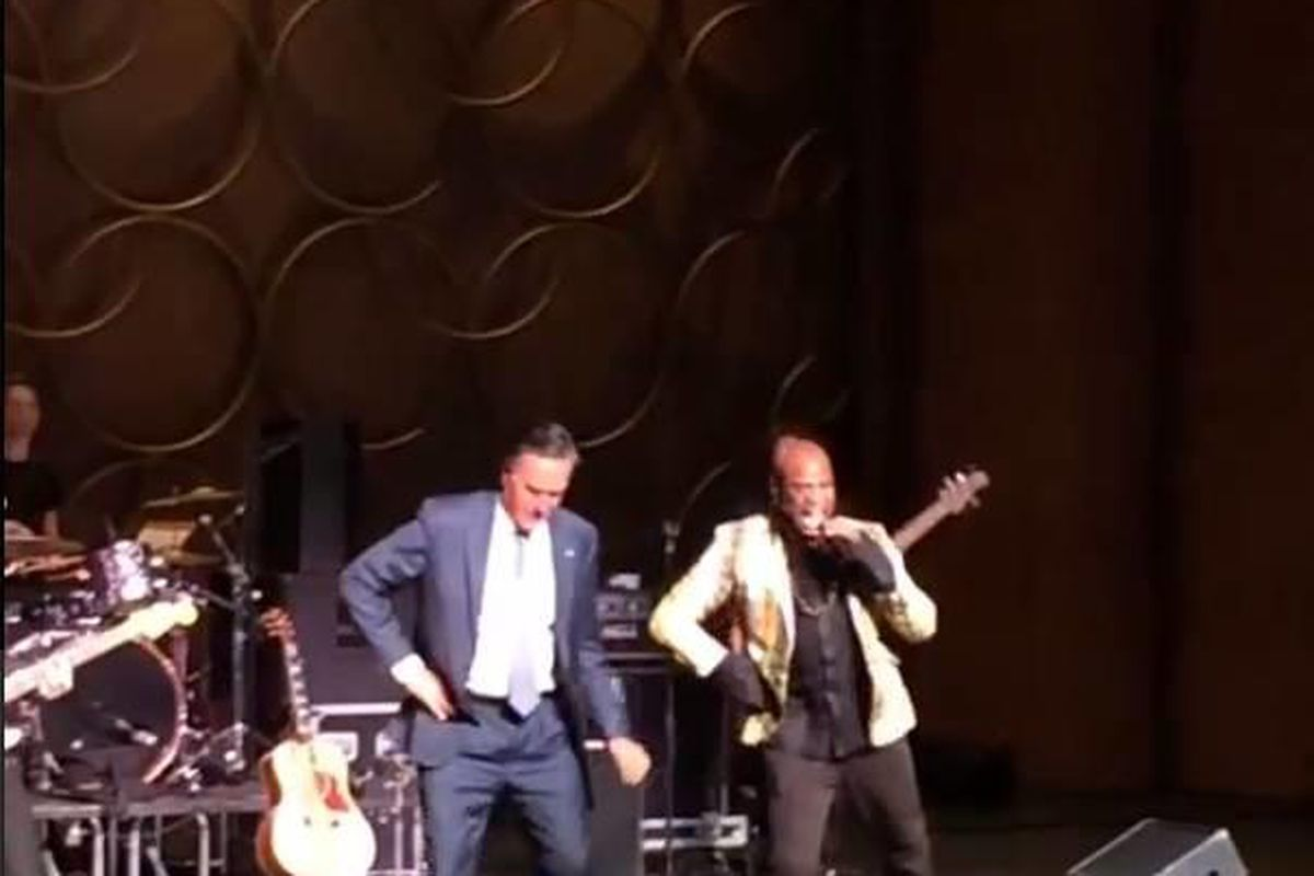 Mitt Romney, left, on stage with Mormon artist Alex Boye.