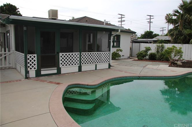 Back of home with pool