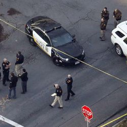 Officials investigate at the scene of an officer involved shooting in the Avenues of Salt Lake City, Thursday, Jan. 8, 2015.