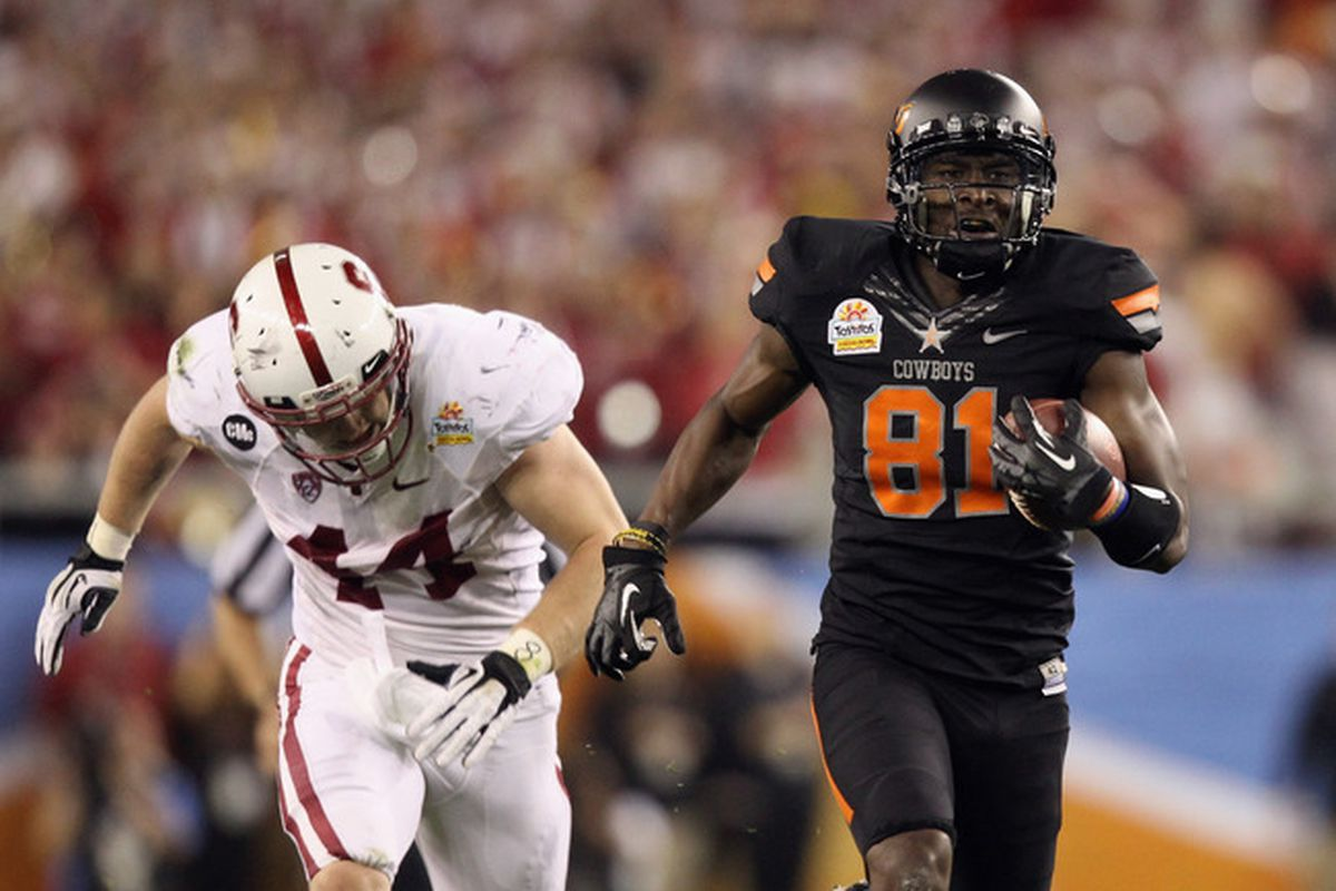 Oklahoma St.'s Justin Blackmon eluded the Stanford defense or 3 touchdowns in the Fiesta Bowl, which the Cowboys eventually won 41-38 in overtime. <em>(Getty Images photo)</em>