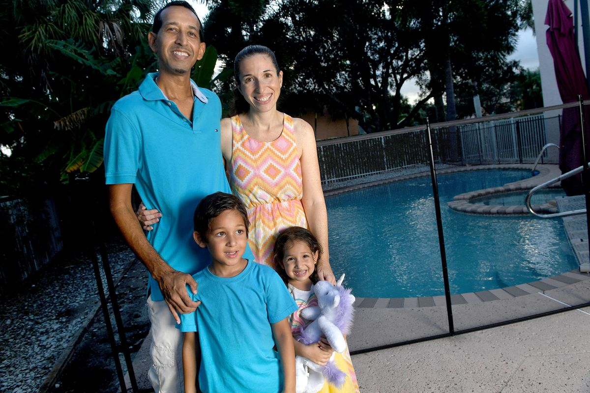 Raif Mohamed, left, and his wife, Rorri Geller-Mohamed, are seen with their children Omar, age 5, and Mia, age 3, at their home in Lake Worth, Fla., Thursday, Sept. 18, 2020. Families that are taking part in the Black Lives Matter movement and are tackling issues of race head-on at home.