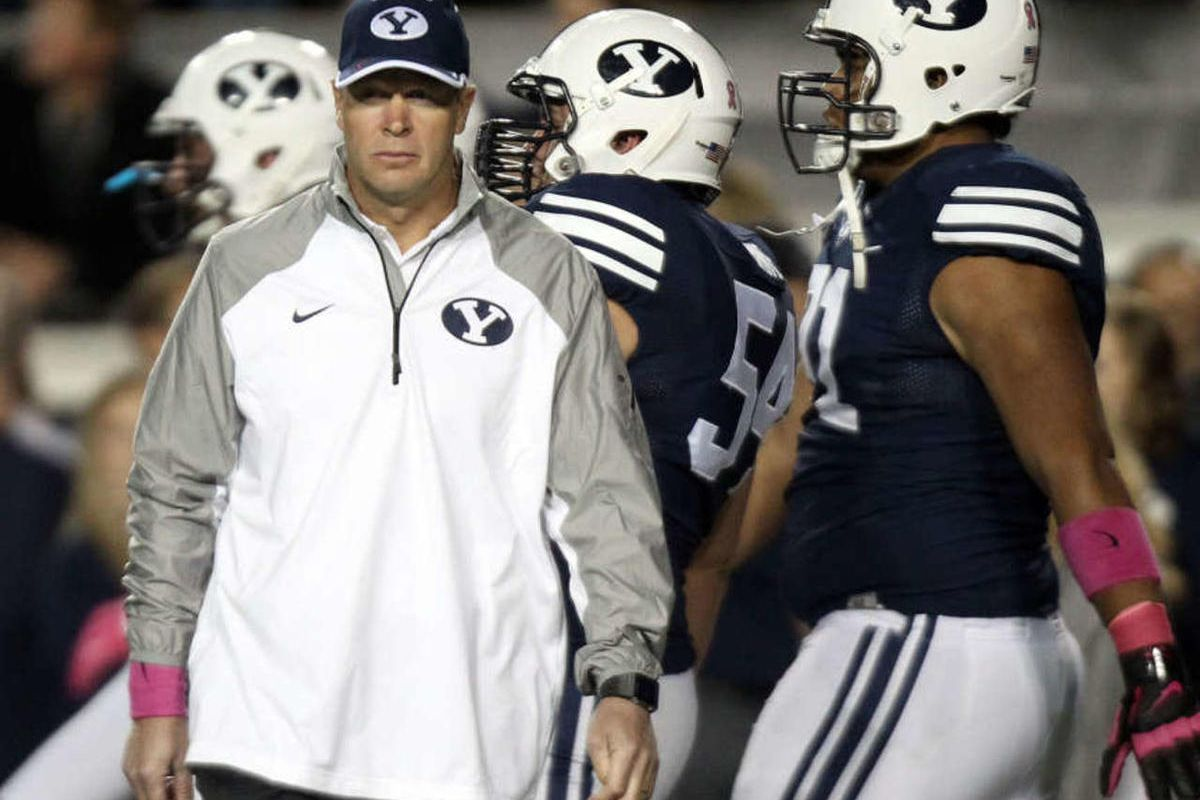 Brigham Young Cougars head coach Bronco Mendenhall walks the field as his players warm up before playing the University of Nevada in a football game at LaVell Edwards Stadium in Provo on Saturday, Oct. 18, 2014.