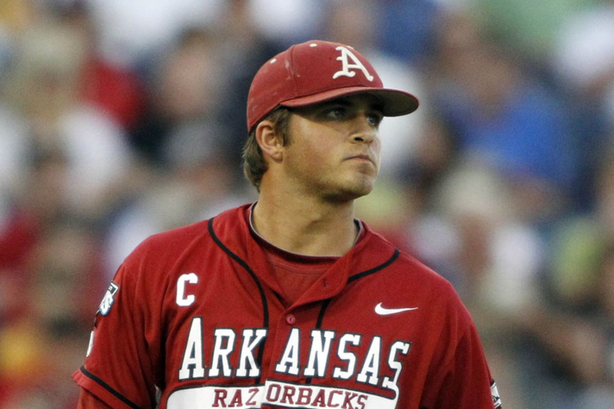 DJ Baxendale pitching for the University of Arkansas in 2012
