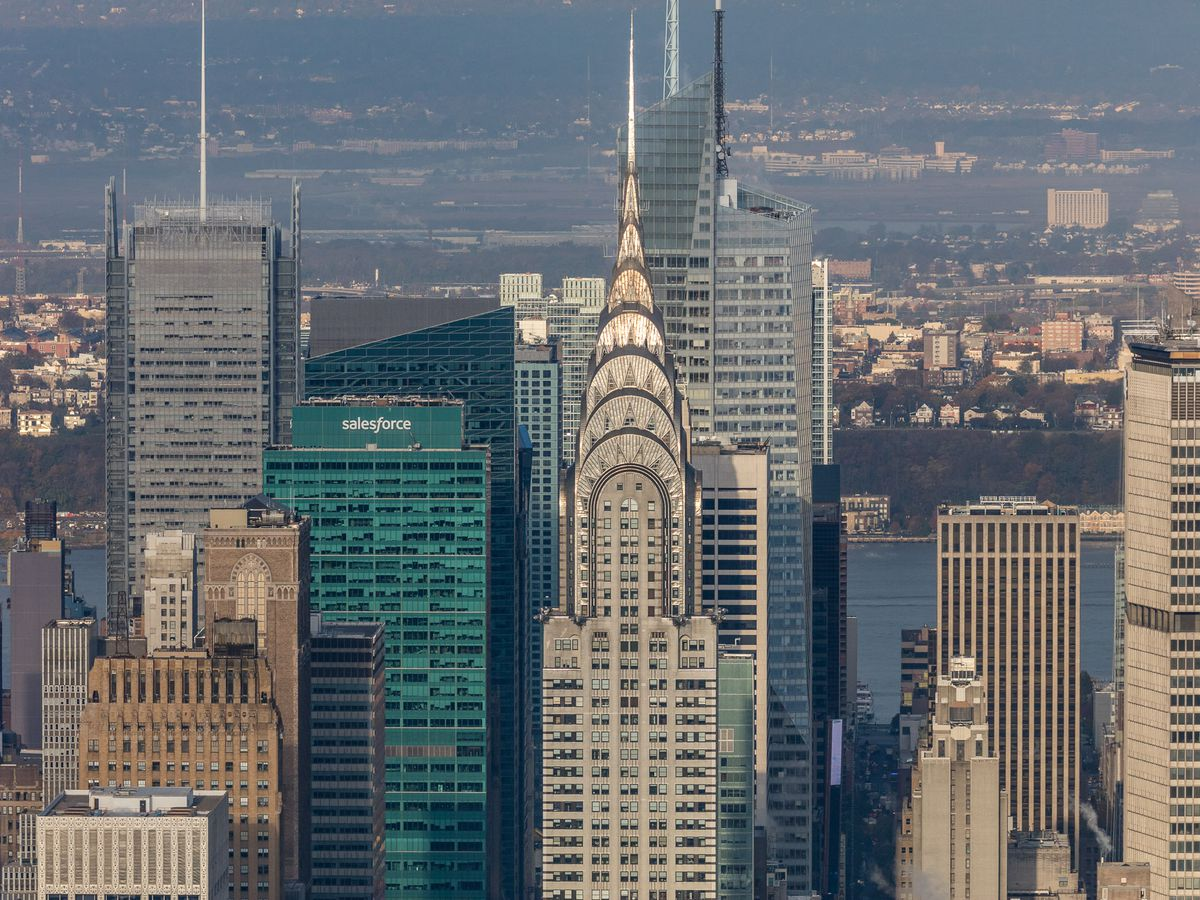 Large skyscrapers and city buildings. In the center is the Chrysler Building.