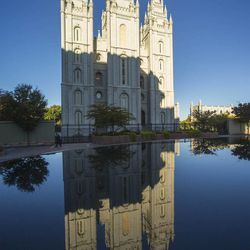 The Salt Lake Temple reflected in the pool on the Church plaza. Sunday morning session of the 183rd Semiannual General Conference for The Church of Jesus Christ of Latter-day Saints Sunday, Oct. 6, 2013, inside the Conference Center.