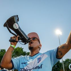 June 25, 2019 - Madison, Wisconsin, United States - A capo for The Flock leads the supporters in song during the Forward Madison FC vs Minnesota United FC friendly match at Breese Stevens Field.