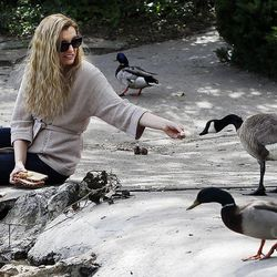 Angela Linford, who has chronic fatigue syndrome, feeds geese and ducks near her home in Salt Lake City, Thursday, May 15, 2014.