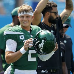 New York Jets quarterback Zach Wilson watches during warm ups before of an NFL football game against the Carolina Panthers Sunday, Sept. 12, 2021, in Charlotte, N.C.