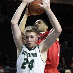 Utah Valley's Jared Stutzman (24) looks to block a shot by Seattle's Brendan Westendorf during the first half of an NCAA college basketball game in the first round of the Western Athletic Conference tournament Thursday, March 9, 2017, in Las Vegas.