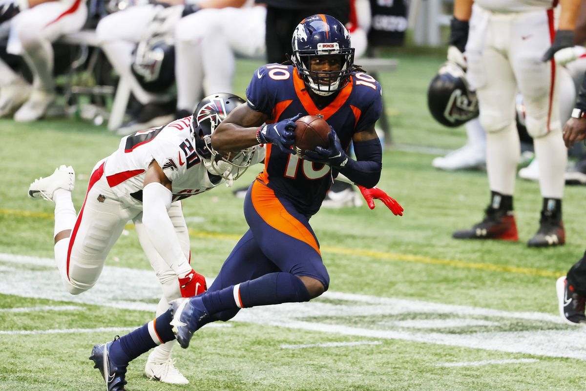 Jerry Jeudy #10 of the Denver Broncos makes a reception against Kendall Sheffield #20 of the Atlanta Falcons during the fourth quarter at Mercedes-Benz Stadium on November 08, 2020 in Atlanta, Georgia.