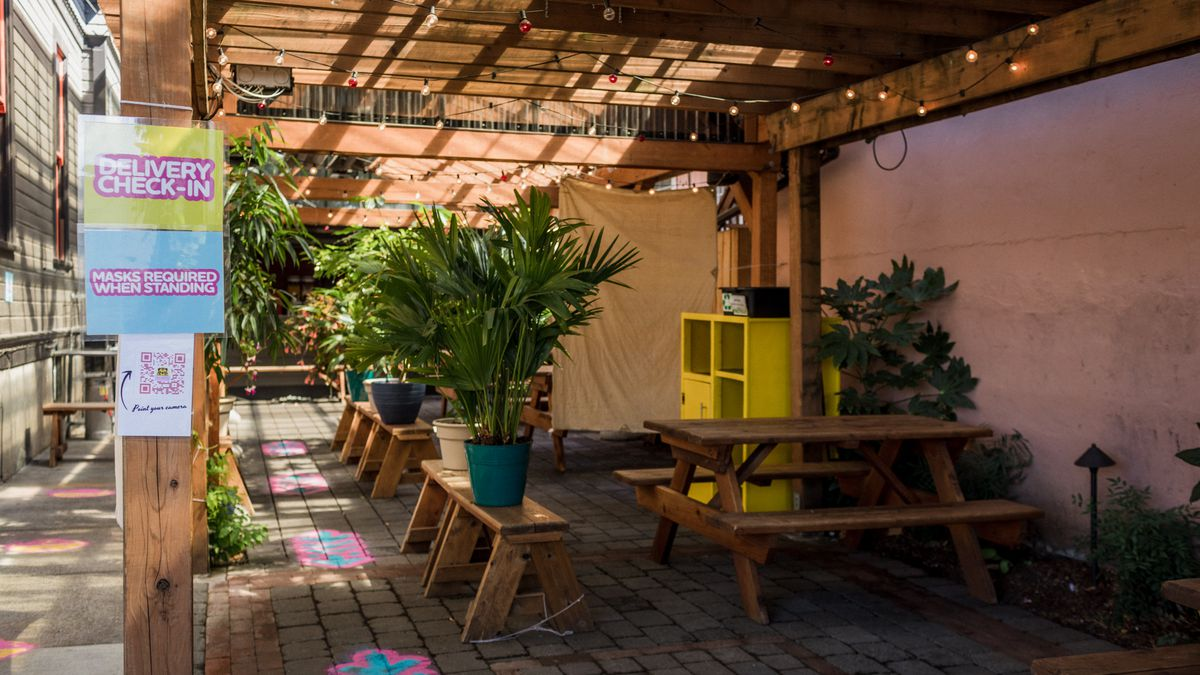 A wooden roof covered the outdoor dining area of Sunshine Noodles