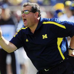 Michigan head coach Brady Hoke yells from the sidelines during the first quarter of an NCAA college football game against Air Force at Michigan Stadium in Ann Arbor, Mich., Saturday, Sept. 8, 2012.