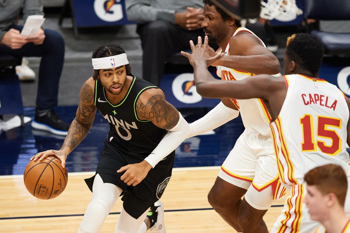 D'Angelo Russell of the Minnesota Timberwolves dribbles the ball against the Atlanta Hawks during the game at Target Center on January 22, 2021 in Minneapolis, Minnesota. The Hawks defeated the Timberwolves 116-98.