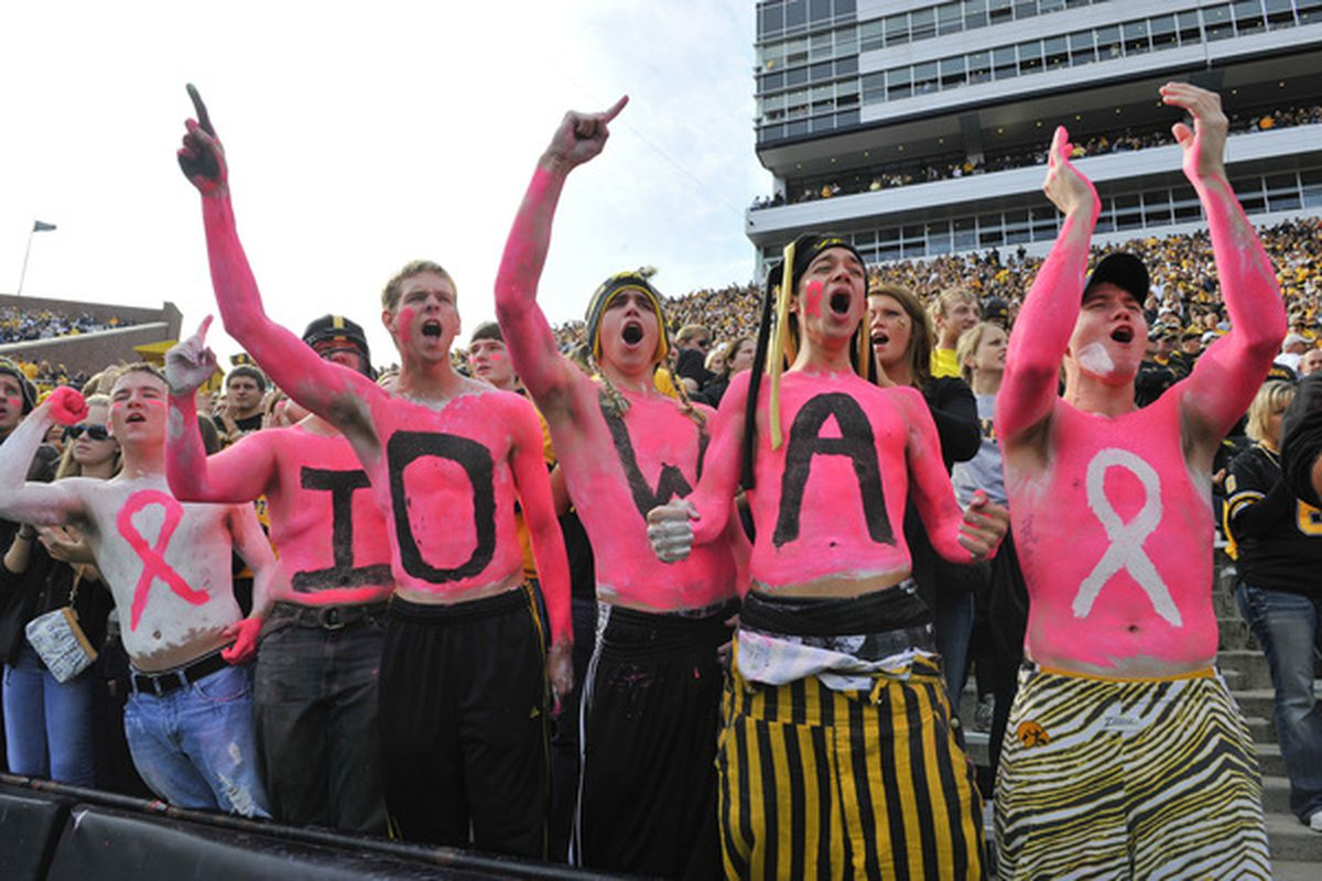 University of Iowa Hawkeyes fans cheer on their team as they take on the Wisconsin Badgers during the first half of play at Kinnick Stadium in Iowa City Iowa. Wisconsin won 31-30 over Iowa. (Photo by David Purdy/Getty Images).