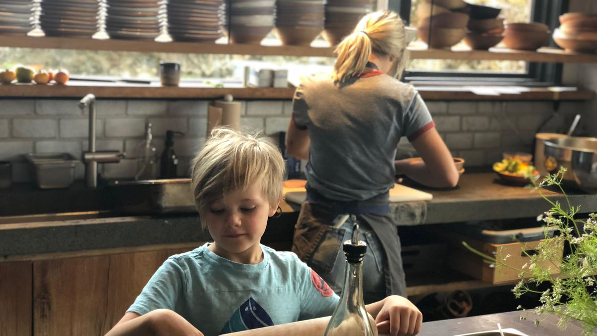 Van Rich, the eldest child of chefs Evan and Sarah Rich, rolls out dough at Scribe Winery. He's now 9 years old.