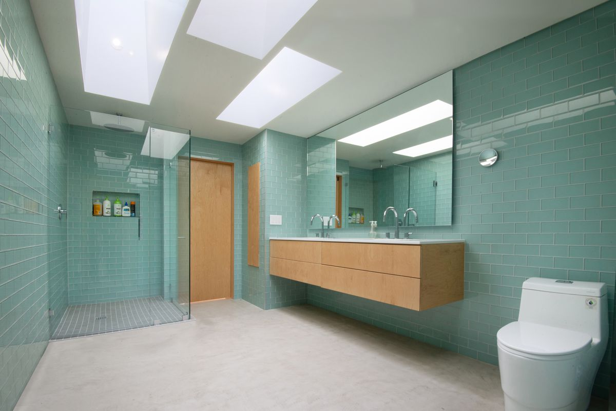 Bathroom covered in green tile