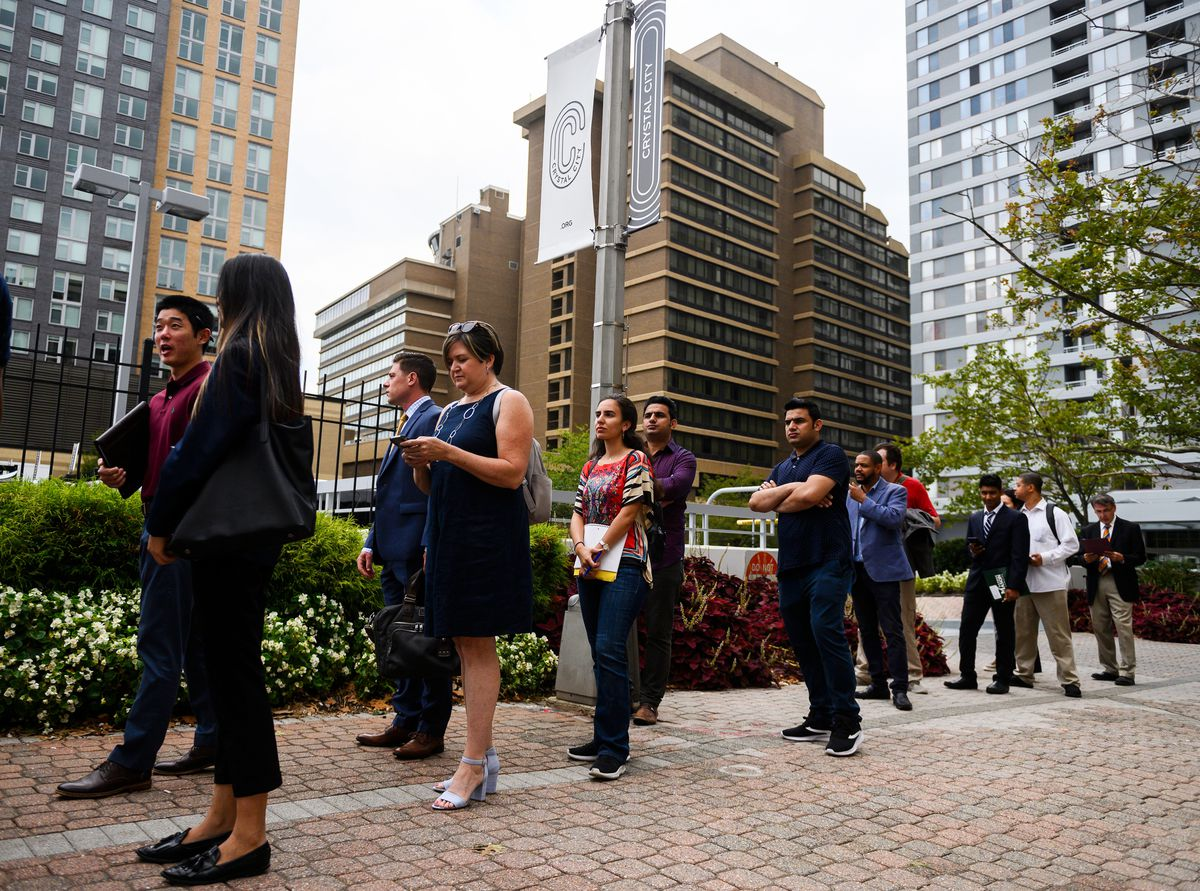 Job seekers stand in line for an Amazon Career Day event.