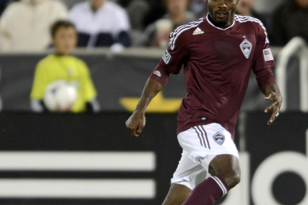 April 28, 2012; Commerce City, CO, USA; Colorado Rapids forward Omar Cummings (14) seduces the ball at Dick's Sporting Goods Park. Mandatory Credit: Ron Chenoy-US PRESSWIRE
