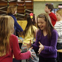 Brooklyn Wersland, left and Emma Webster exercise in Nicole Carter's class at Tolman Elementary School in Bountiful, Monday, Nov. 26, 2012.